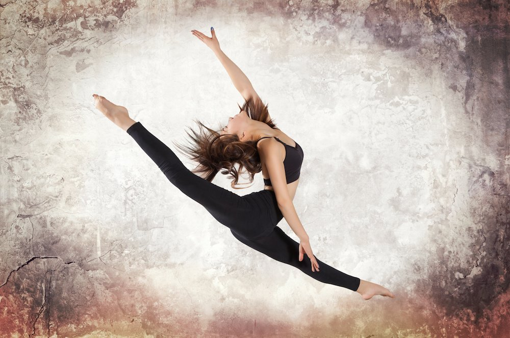 Dance studio Young woman ballet dancing on wall background