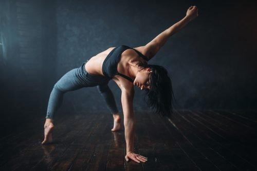 Footworks Dance Studio - Contemporary dancing female performer in dance studio