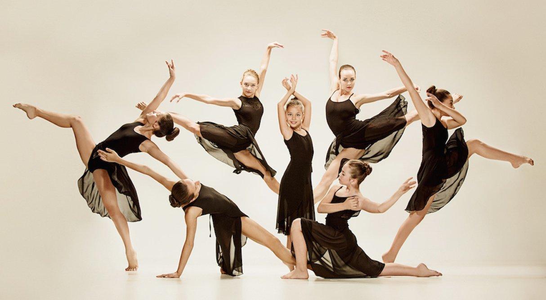 Modern ballet dancers dancing in dance studio