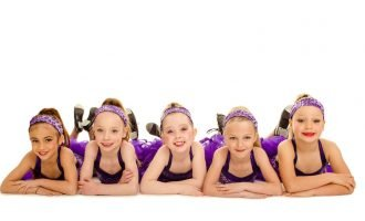 Dance Studio Junior Tap Dancers posing in costume